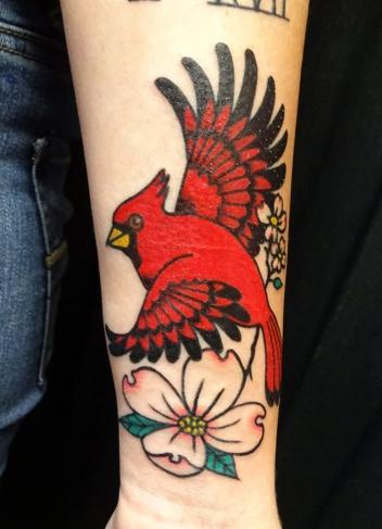 Cardinal and dogwood flowers